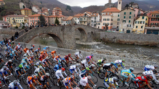 The peloton hums past the colour along the roads of the Milan-San Remo race (Reuters)