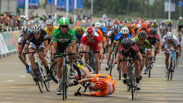But it was all going so well.. Tom Palmer (centre, red) caught behind a crash at the Tour of Hainan. (Supplied)