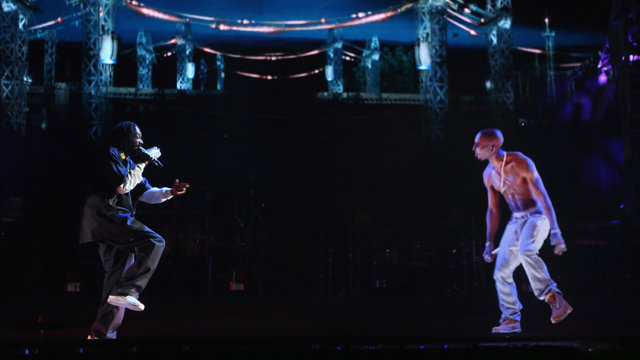 Rapper Snoop Dogg (L) and a hologram of deceased rapper Tupac Shakur perform onstage during day 3 of the 2012 Coachella Valley Music & Arts Festival (Getty Images)