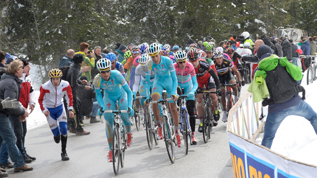 The Astana team of race Giro d'Italia winner Vincenzo Nibali leads the peloton through the snow of Stage 20 (Sirotti)