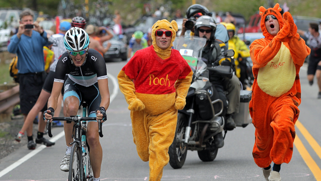 Andy Schleck is chased by Pooh and Tigger as he attacks on the climb of Swan Mountain during stage five of the 2011 USA Pro Cycling Challenge (Getty)