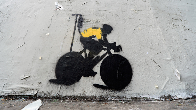 Stencil art depicting Lance Armstrong attached to an IV drip pictured on the side of a building in Los Angeles (Getty)
