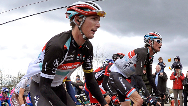 Andy Schleck (foreground) and brother Frank (background) at the Liege-Bastogne-Liege (AAP Images)