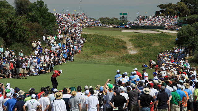 Tiger Woods plays a tee shot during the 2011 Presidents Cup (Getty)