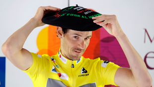 Radioshack's Andreas Kloden dons a Basque beret after winning the six-day Tour of the Basque Country (Reuters)