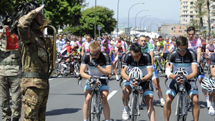 SOLEMN: With heads bowed, Leopard-Trek riders front the Stage 4 start in Quarto dei Mille. Photo: RCS SPORT