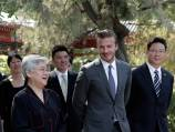 Beckham shines amid China gloom