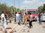Iraq bomb blasts kill dozens