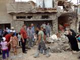 Iraq car bombs kill 12, wound 30