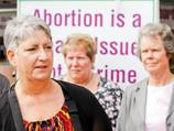 Calls for law reform after abortion case