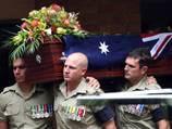 Soldier laid to rest as son is born