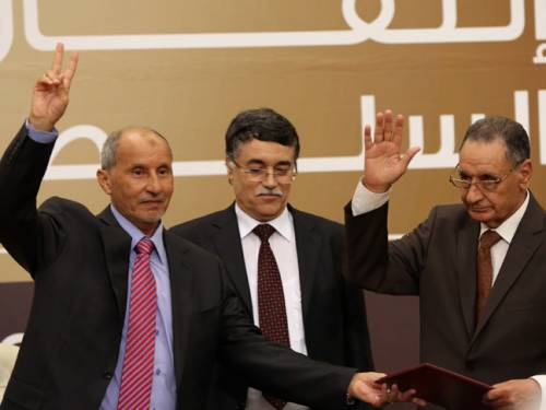 Libya's National Transitional Council's chief, Mustafa Abdel Jalil (L), Kamal Edhan the President of the Supreme Court in Libya (C), Mohammad Ali Sulayem, Chairman of the National Conference (R) during the transfer of authority ceremony in Tripoli. (Getty)