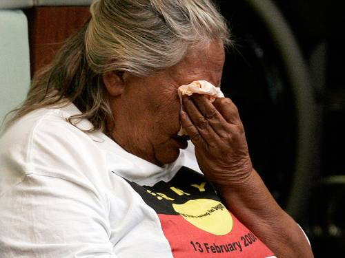An Indigenous Australian cries in parliament in 2010 as then PM Kevin Rudd delivers an apology for injustices committed over two centuries of white settlement. (AAP)