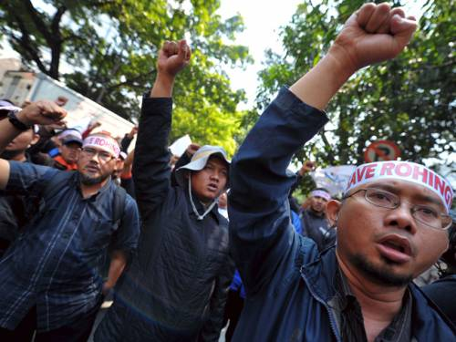 Demonstrators protest against Myanmar's treatment of Muslim Rohingya outside the Myanmar embassy in Jakarta. (Getty)