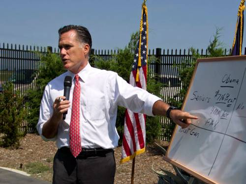 Republican presidential candidate, Mitt Romney points to a white board as he talks about Medicare during a news conference. (AAP)