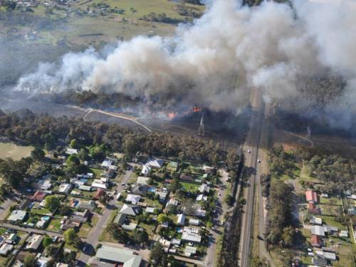 A major bushfire on the NSW Central Coast has been contained by firefighters. (AAP)