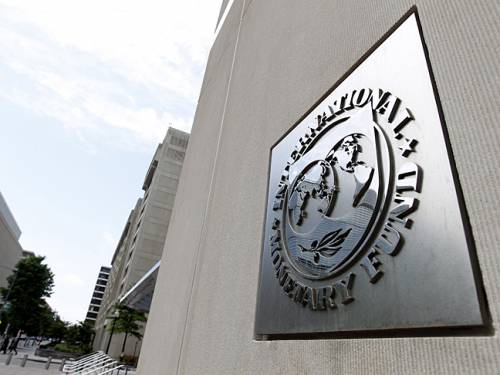 In its latest World Economic Outlook, released on Tuesday, the IMF said it believes global prospects are improving, although downside risks remain. (AAP)