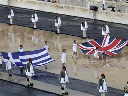The British and Greek flags are carried into the marble Panathenaic stadium during an Olympic Flame ceremony in Athens May 17, 2012. REUTERS/Yorgos Karahalis