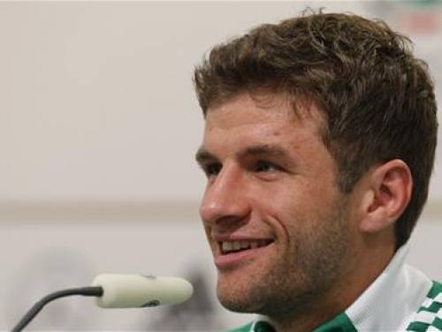 Germany's national soccer player Thomas Mueller smiles during a news conference before their Euro 2012 soccer match against Greece in Gdansk, June 20, 2012. REUTERS/Thomas Bohlen