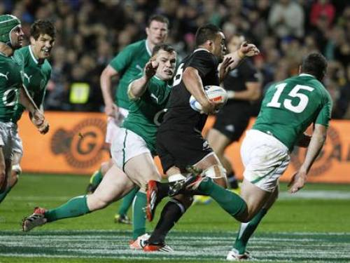 New Zealand All Blacks' Liam Messam (with ball) runs past Ireland's Cian Healy (C) and Rob Kearney (R) to score a try during their international rugby test match in Hamilton June 23, 2012. REUTERS/Nigel Marple