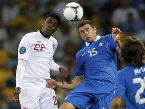 England's Danny Welbeck (L) goes for a header with Italy's Andrea Barzagli (C) as Italy's Andrea Pirlo (R) looks on during their Euro 2012 quarter-final soccer match at the Olympic Stadium in Kiev, June 24, 2012. REUTERS/Gleb Garanich
