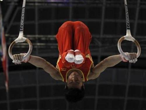 China's Teng Haibin competes on the rings during the men's team final at the Artistic Gymnastics World Championships in Tokyo October 12, 2011. REUTERS/Kim Kyung-Hoon