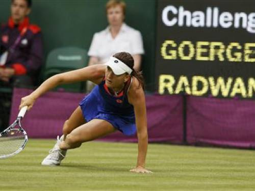 Poland's Agnieszka Radwanska falls while returning to Germany's Julia Goerges in their women's singles tennis match at the All England Lawn Tennis Club during the London 2012 Olympics Games July 29, 2012. REUTERS/Stefan Wermuth