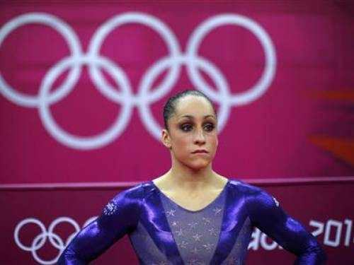 Jordyn Wieber of the U.S. waits after performing on the vault during the women's gymnastics qualification in the North Greenwich Arena during the London 2012 Olympic Games July 29, 2012. REUTERS/Brian Snyder