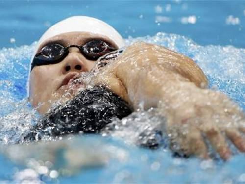 China's Ye Shiwen swims to a first place finish during her women's 200m individual medley heat at the London 2012 Olympic Games at the Aquatics Centre July 30, 2012. REUTERS/David Gray