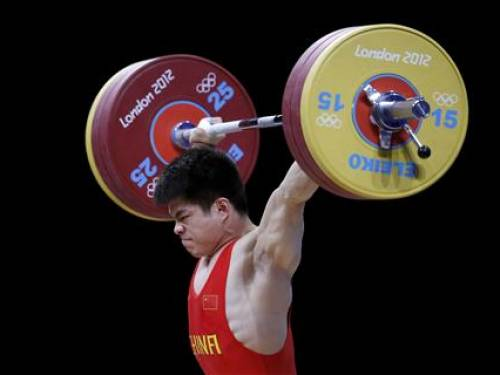 China's Qingfeng Lin competes on the men's 69Kg Group A weightlifting competition at the ExCel venue at the London 2012 Olympic Games July 31, 2012. REUTERS/Paul Hanna