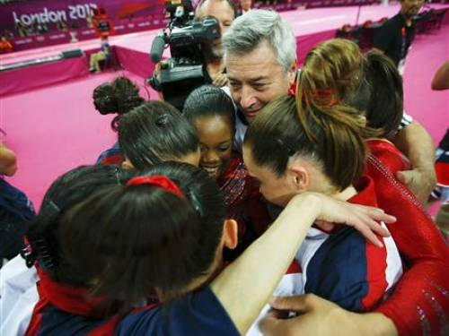 Team U.S.A. members embrace after they learned that they won gold in the women's gymnastics team final in the North Greenwich Arena at the London 2012 Olympic Games July 31, 2012. REUTERS/Brian Snyder