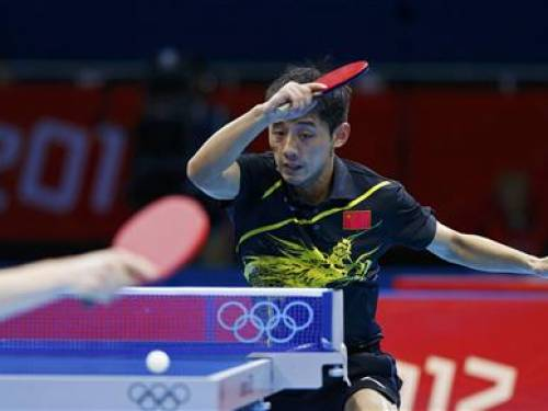 China's Zhang Jike hits a return to Germany's Dimitrij Ovtcharov in their men's singles semifinals table tennis match at the ExCel venue during the London 2012 Olympic Games August 2, 2012. REUTERS/Grigory Dukor