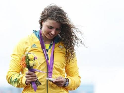 Silver medallist Australia's Jessica Fox looks at her medal while on the podium during the victory ceremony for the women's kayak (K1) final at Lee Valley White Water Centre during the London 2012 Olympic Games August 2, 2012. REUTERS/Suzanne Plunkett