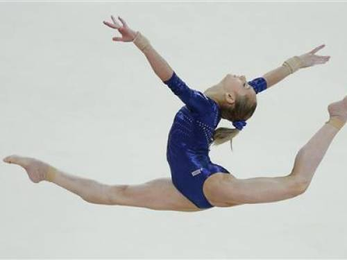 Russia's Victoria Komova performs her floor exercise during the women's individual all-around gymnastics final in the North Greenwich Arena at the London 2012 Olympic Games August 2, 2012. REUTERS/Phil Noble