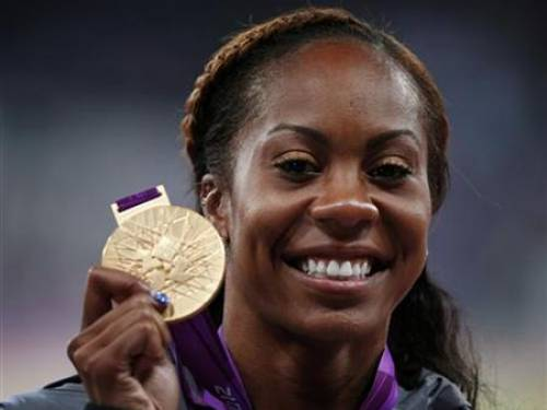 Gold medallist Sanya Richards-Ross of the U.S. poses during the women's 400m victory ceremony at the London 2012 Olympic Games at the Olympic Stadium August 5, 2012. REUTERS/Eddie Keogh