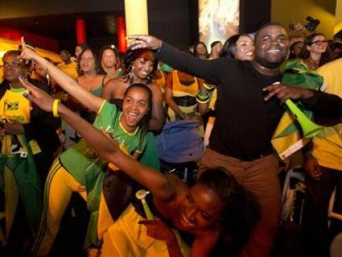 Jamaican supporters in the House of Jamaica in the O2 centre react as Jamaica's Usain Bolt wins the men's 100m final during the London 2012 Olympic Games August 5, 2012. REUTERS/Neil Hall