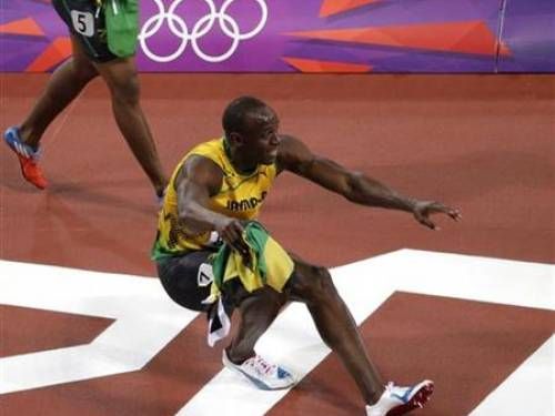 Jamaica's Usain Bolt performs a somersault as he celebrates winning the men's 100m final during the London 2012 Olympic Games at the Olympic Stadium August 5, 2012. REUTERS/Cathal McNaughton
