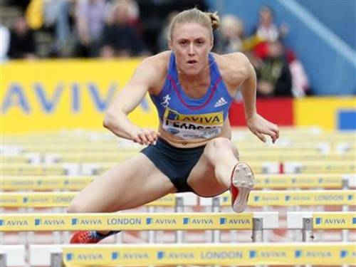 Sally Pearson of Australia competes in the women's 100m hurdles heats during the Diamond League London Grand Prix athletics meet at Crystal Palace in London July 14, 2012. REUTERS/Suzanne Plunkett