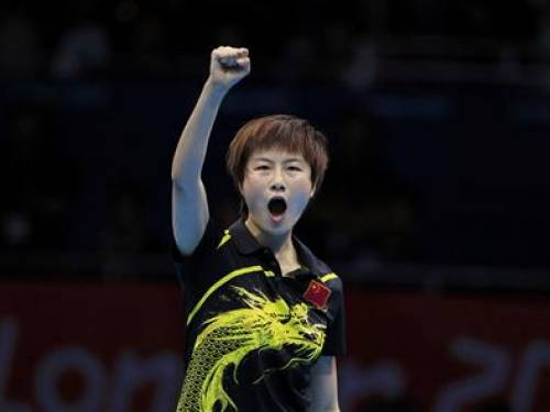 China's Ding Ning celebrates after defeating Japan's Kasumi Ishikawa in their women's team gold medal table tennis singles match at the ExCel venue during the London 2012 Olympic Games August 7, 2012. REUTERS/Chris Helgren