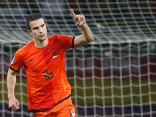 Netherlands' Robin van Persie celebrates after scoring a goal during their Group B Euro 2012 soccer match against Germany at the Metalist stadium in Kharkiv, June 13, 2012. REUTERS/Michael Buholzer