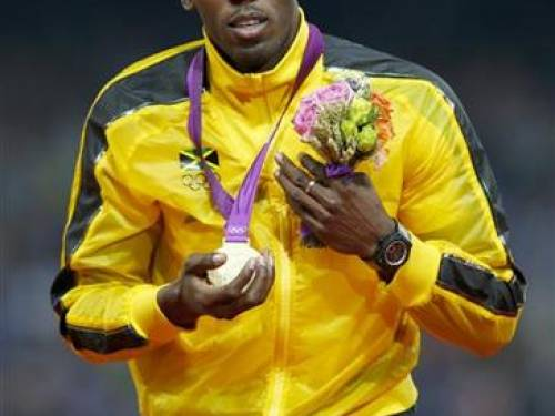 Jamaica's Usain Bolt celebrates after receiving his gold medal at the men's 4x100m relay victory ceremony at the London 2012 Olympic Games at the Olympic Stadium August 11, 2012. REUTERS/Eddie Keogh