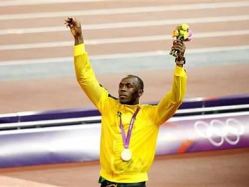 Jamaica's Usain Bolt celebrates after receiving his gold medal at the men's 4x100m relay victory ceremony at the London 2012 Olympic Games at the Olympic Stadium August 11, 2012. REUTERS/Gary Hershorn