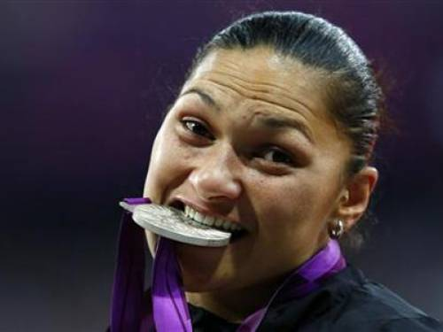New Zealand's Valerie Adams bites her silver medal in the women's shot put victory ceremony during the London 2012 Olympic Games at the Olympic Stadium August 6, 2012. REUTERS/Eddie Keogh
