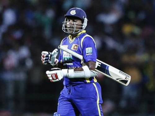 Sri Lanka's captain Mahela Jayawardene reacts he walks off the field after his dismissal during the Twenty20 match against India in Pallekele August 7, 2012. REUTERS/Dinuka Liyanawatte