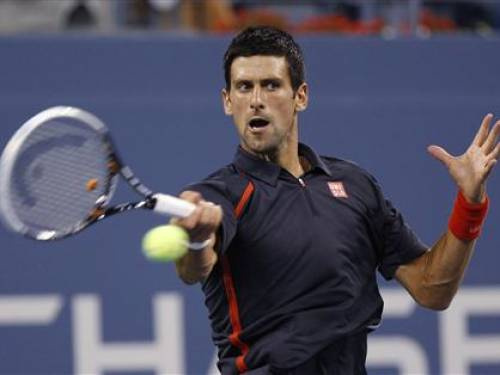 Novak Djokovic of Serbia returns a shot to Paolo Lorenzi of Italy during their match at the US Open men's singles tennis tournament in New York, August 28, 2012. REUTERS/Adam Hunger