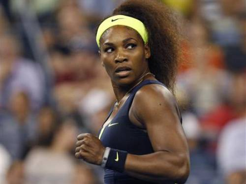 Serena Williams of the U.S. celebrates a shot against Coco Vandeweghe of the U.S. during their match at the US Open women's singles tennis tournament in New York, August 28, 2012. REUTERS/Adam Hunger