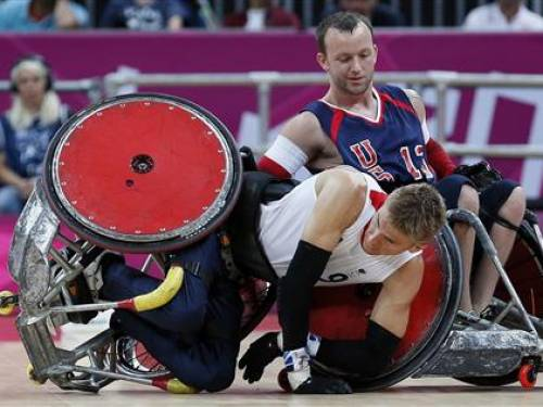 Britain's Steve Brown falls during their Wheelchair Rugby match against the U.S during the London 2012 Paralympic Games at the Olympic Stadium in London, September 5, 2012. REUTERS/Stefan Wermuth