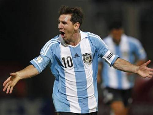 Argentina's Lionel Messi celebrates after scoring their third goal against Paraguay in a 2014 World Cup qualifying soccer match. (Reuters)