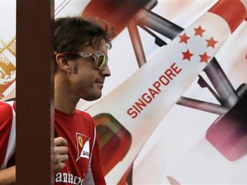 Ferrari Formula One driver Fernando Alonso of Spain enters the paddock ahead of the Singapore F1 Grand Prix in Singapore September 20, 2012.