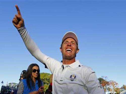 Team Europe golfer Nicolas Colsaerts of Belgium celebrates winning the Ryder Cup for Europe during the 39th Ryder Cup singles golf matches at the Medinah Country Club in Medinah, Illinois, September 30, 2012. REUTERS/Mike Blake